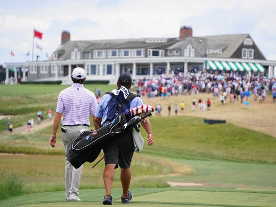 Philip Barbaree Jr. and caddie Roy Lang III head toward the iconic clubhouse at Shinnecock Hills during the 2018 U.S. Open.