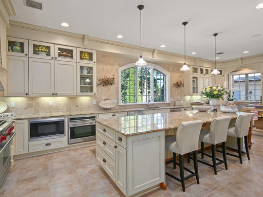 The Gourmet kitchen features top of the line appliances with porcelain floors and generous center island.