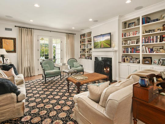 The family room features a one-of-a-kind custom bookshelf and a fireplace.