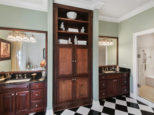 The Master bathroom features his and her custom sinks and a dressing room.