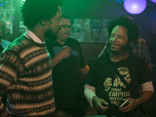 "Lakeith Stanfield (left) and Boots Riley (right) on the set of ""Sorry to Bother You."""