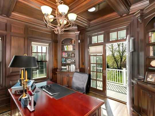 This home features a private custom office with a set of French doors.