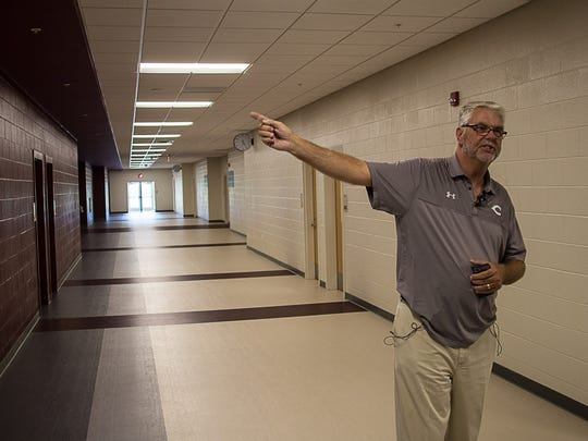 Superintendent John Aitken leads a tour of the new Collierville High School.