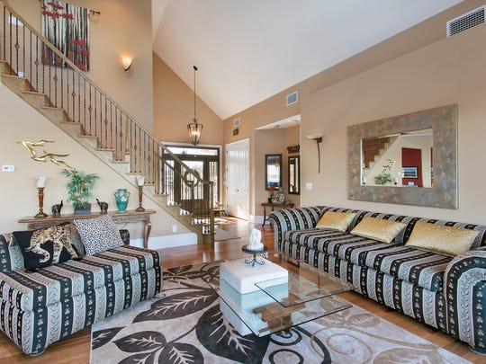 The living room offers an open floor plan with decorative molding.