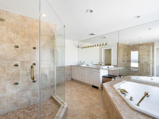 The master suite features double his and her sinks with a huge jetted tub.