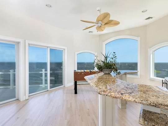 The home offers water views with customized windows.