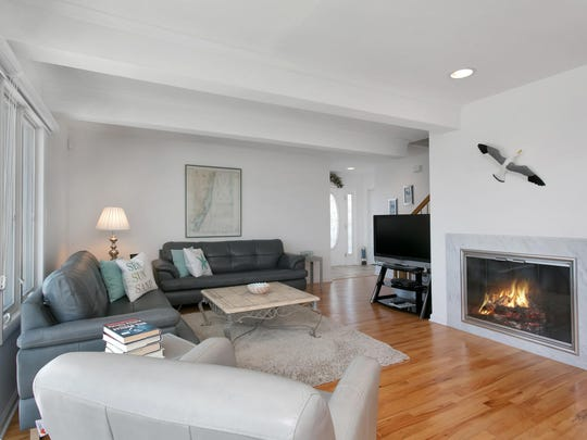 The family room features recessed lighting, hardwood floors, and a fireplace.