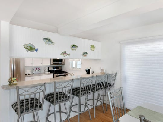 The kitchen features multi custom cabinetry and a breakfast nook.
