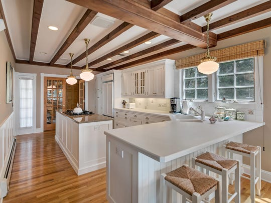The kitchen has a Corian center island and a breakfast bar.