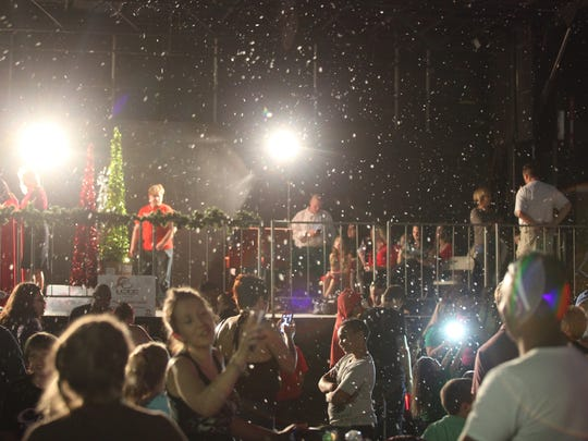 Visitors to Downtown Cape Coral attend the CenturyLink Holiday Festival of Lights on Saturday.