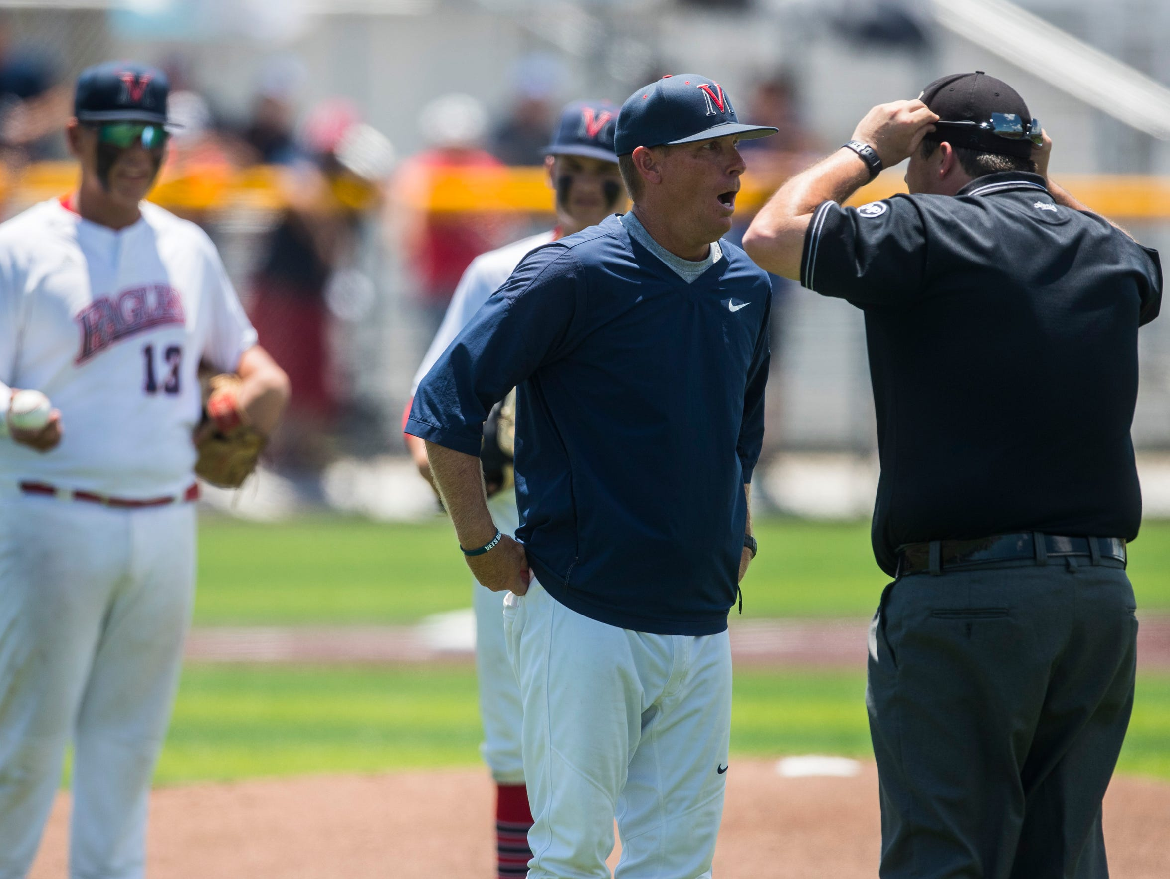 Veterans Memorial head coach Lee Yeager argues a call