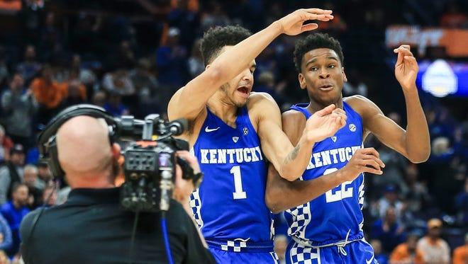 Kentucky's Sacha Killeya-Jones, left, and Shai Gilgeous-Alexander celebrate in the second half in the Wildcats' 77-72 win over Tennessee Sunday in St. Louis for the SEC Championship. March 11, 2018