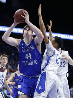 Covington Catholic's Jake Walter, 44, shoots against Oldham County'sChristian Harper, 34, during a semi final game of the Whitaker Bank/KHSAA Boys' Sweet 16 basketball tournament played at Rupp Arena in Lexington, Ky. Saturday March 17, 2018.