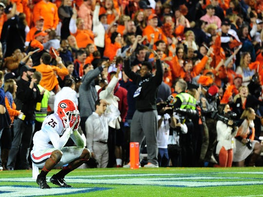 Safety Josh Harvey-Clemons, now at U of L, reacts after Auburn's last-minute touchdown heave to beat Georgia in 2013. Harvey-Clemons tipped the Auburn pass on the famous play.