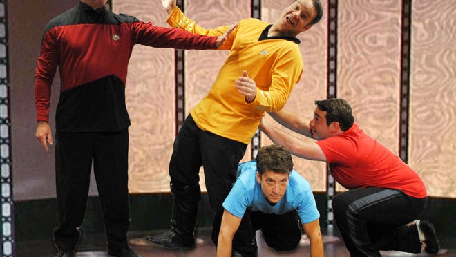 Captain Picard (Joey Arena), Dr. McCoy (Scott Davis) and Scotty (Denny Grinar) have a little Transporter Room fun with Captain Kirk (Kenn Parks).