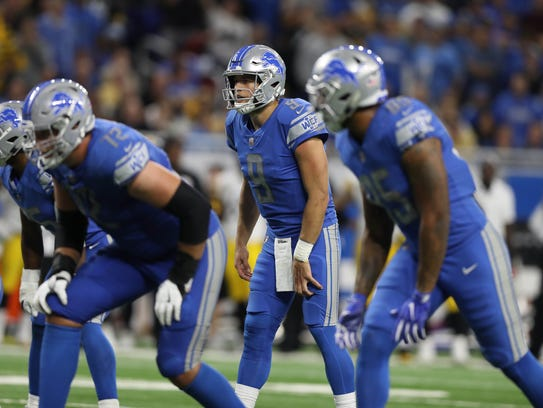 Matthew Stafford runs a play against the Steelers during the fourth quarter of the Lions' 20-15 loss Sunday.