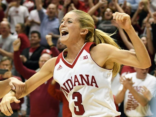 Indiana Hoosiers guard Tyra Buss (3) celebrates after