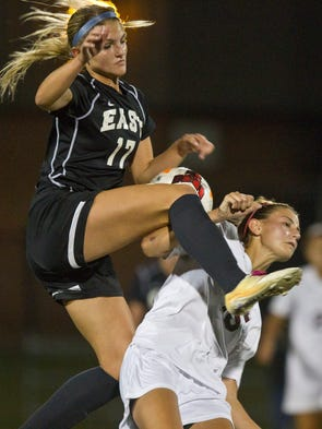 Toms River East's Brielle Zagacki (17) collides with