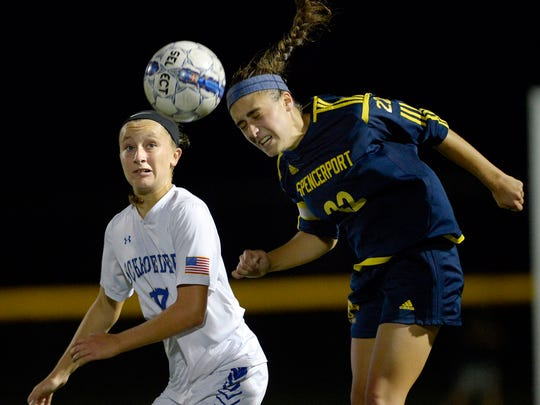 Spencerport's Olivia Wall, right, wins a header in front of Webster Schroeder's Anna Hewlett, left.