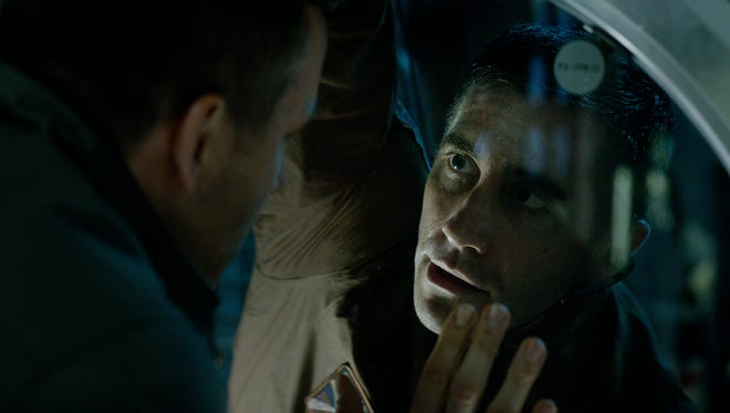 """Ryan Reynolds (left) and Jake Gyllenhaal find life in outer space, and it turns out to be a problem, in """"Life."""""""
