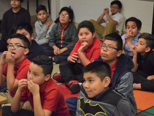 Fourth graders at IPS School 96 look on during a RightFit