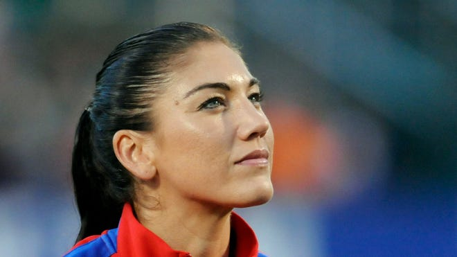 U.S. goalkeeper Hope Solo (1) stands for the playing of the national anthem prior to the first half of a game against Mexico at Sahlen's Stadium. The USA won 4-0.