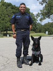 Bolt and Michigan State Police Trooper David Cardenas.