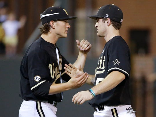 Vanderbilt winning pitcher Carson Fulmer, left, celebrates with catcher Jason Delay after Vanderbilt defeated Oregon 7-2 in an NCAA college baseball tournament regional game Saturday, May 31, 2014, in Nashville, Tenn. (AP Photo/Mark Humphrey)