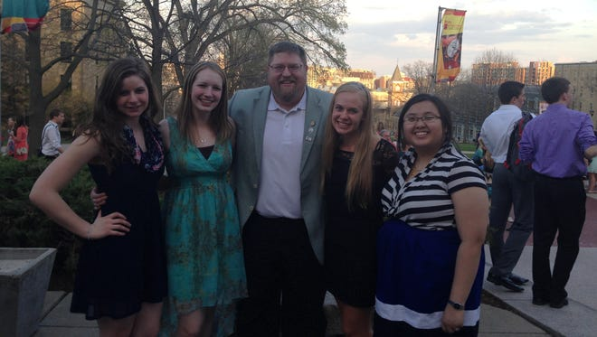 The Northland Lutheran High School Forensics Team captains pose with coach Nate Lauber following the state Speech Festival on April 17. Taylor Fenske, from left, McKenzie Grant, Olivia Nillissen and Maiyer Yang surround Lauber.