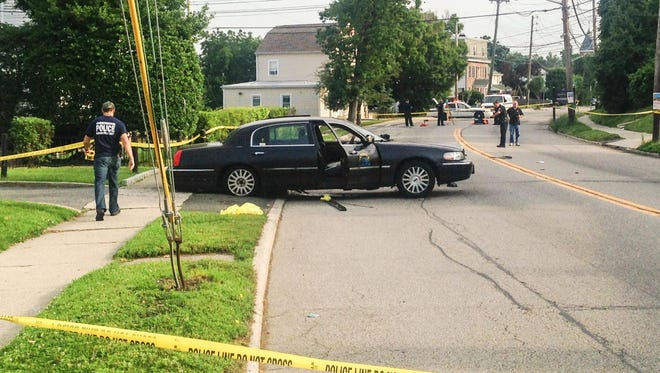 Police investigate an accident on Route 9 in Ossining village that sent two people to the Westchester Medical Center, June 23, 2015.