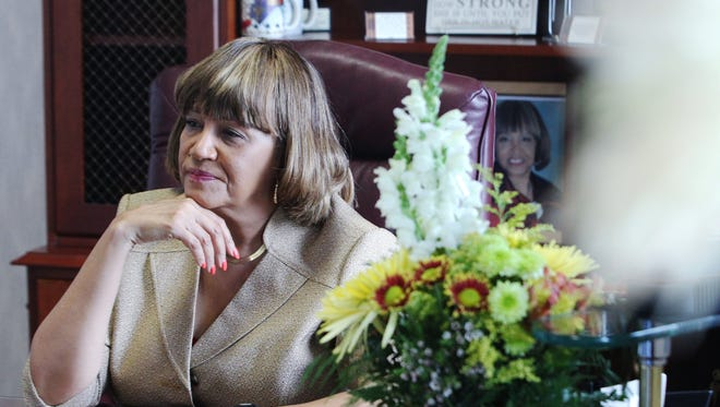 Anita Favors Thompson sits behind her desk on the fourth floor of City Hall. She retired Friday after 18 years as Tallahassee city manager.