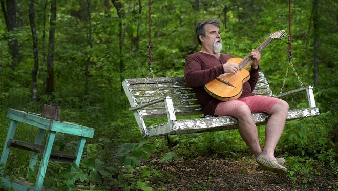 Singer-songwriter Darrell Scott lives at his sustainable homestead in East Tennessee.