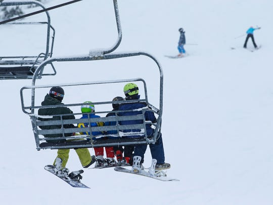 Winter enthusiasts take advantage of early snow at the Hoodoo Ski Area on Sunday, Dec. 20.