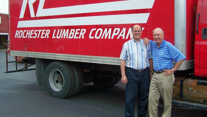 Jerry Stahl (right) and his nephew Glenn Stahl pictured outside a company truck in East Rochester. Jerry has been president of Rochester Lumber since 1982. Glenn is the company's vice president.