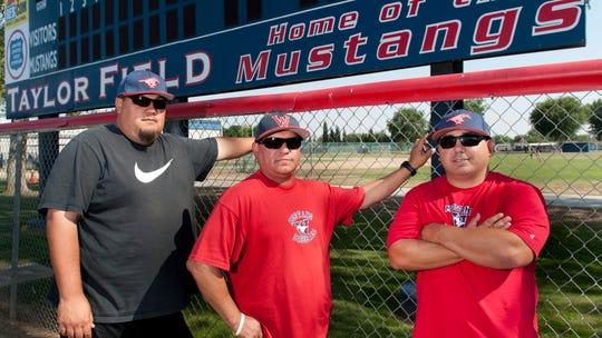 Tulare Western baseball coaches Justin Cuellar, left,