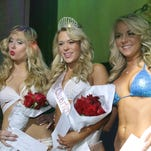 Arika Burrow, center, won the title of Miss Seville Quarter 2014 Friday night.  Maia Kavchak, left, placed second and Shawna Lee, right, placed third.