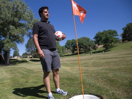 Shop attendant Glen Hoerner describes the rules of footgolf Friday during a demonstration at the Civitan Golf Course in Farmington.