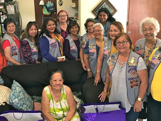 "In keeping with the club's mission of ""Caring for the Sick and the Elderly,"" members of the Guam Sunshine Lions Club brightened Lydia Nostratis' day, 80, of Yigo with gifts of nutritional and hygienic supplies, songs, and cheer at her residence Nov. 25. Pictured seated from left: Lion Pete Babauta and Mrs. Nostratis. Standing from left: Lions Connie Rivera, LouJean Borja, Marietta Camacho, Clarice Quichocho, Lorraine Rivera, Doris Limtiaco, Mary Taitano, Dot Leon Guerrero, Helen Colby, Violet Camacho, Julie Cruz, Jill Pangelinan, Lola Flores, and Annie Artero."