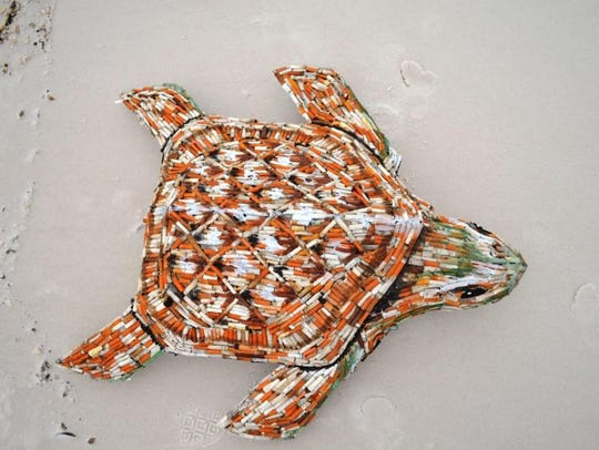 """""""Cig,"""" a sea turtle sculpture made of cigarette butts,"""