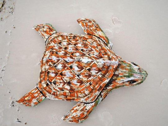 """Cig,"" a sea turtle sculpture made of cigarette butts, was created by marine biologist and artist Shelly Marshall to show effect of trash on marine life. Cig will be on display at the Navarre Beach Sea Turtle Conservation Center through the month of February beginning Friday."
