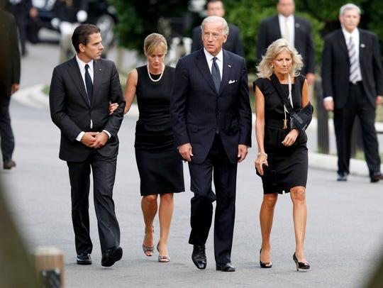 Hunter and Kathleen Biden (left) accompany Hunter's
