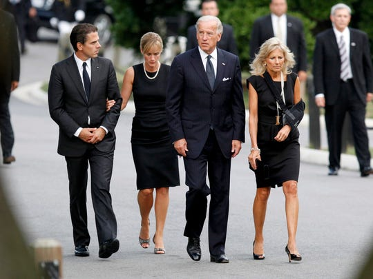 Hunter and Kathleen Biden (left) accompany Hunter's father, Vice President Joe Biden, and wife Jill at Arlington National Cemetery for the burial of Sen. Edward Kennedy on Aug. 29, 2009, in Arlington, Virginia.