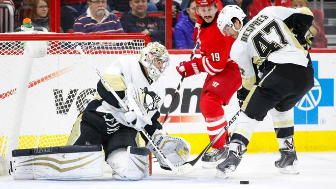 Pittsburgh Penguins goalie Thomas Greiss (1) and defensemen Simon Despres (47) watch the puck in front of the Carolina Hurricanes forward Jiri Tlusty (19) during the second period at PNC Arena.