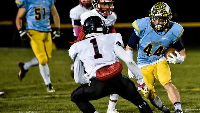 River Valley's Sam Troutman looks for a way around Marion Harding's Garey Moaney during the Marion Harding at River Valley football game on Friday night.
