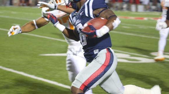University of Tennessee's Brian Randolph pushes Ole Miss' Jaylen Walton out of bounds stopping Walton at 40 yards.