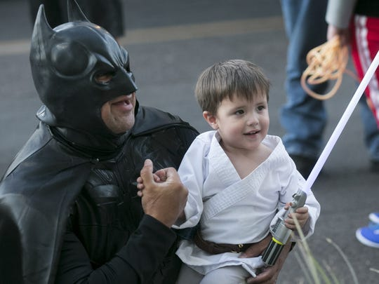 Leon Jimenez (left) dresses as Batman takes a photo