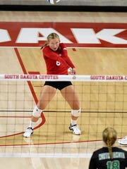 USD's Lauren Mattison bumps the ball to UND during their game at the Sanford Coyote Sports Center on Tuesday in Vermillion.