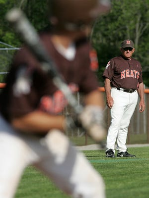 Heath coach Dave Klontz watches a hitter during a 2013 game. Klontz will receive the ABCA Ethics in Coaching Award in January.