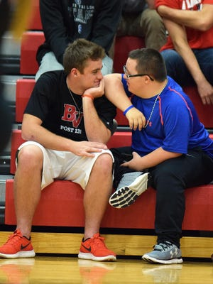 """Wilson Kolbeck and Connor Rowbotham, who have formed a friendship through the Best Buddies program, attend a recent high school volleyball game together. Sometmes, as this photo shows, """"Best Buddies"""" can share something as simple as a shoulder to lean on. Best Buddies, which is an international program, was launched at Brandon Valley High SChool this year, and has drawn higher than expected numbers."""