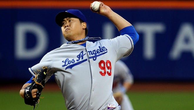 Dodgers starting pitcher Hyun-Jin Ryu delivers a pitch against the New York Mets in the first inning at Citi Field.